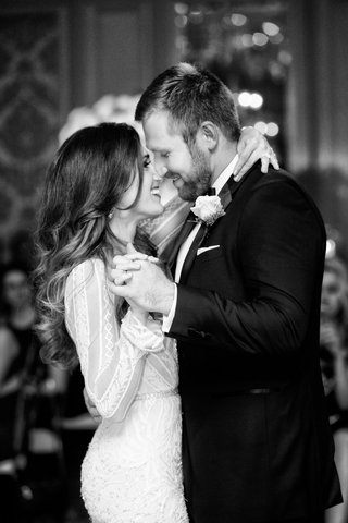 black-and-white-photo-of-bride-in-inbal-dror-wedding-dress-with-groom-in-tuxedo-touching-noses