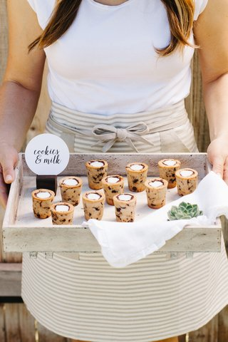 woman-server-with-tray-full-of-chocolate-chip-cookie-shots