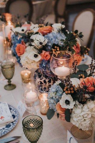 wedding-reception-centerpiece-blue-and-white-vase-anemone-hydrangea-rose-blue-pink-green