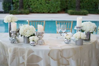 poolside-wedding-reception-sweetheart-table-silver-mercury-glass-vases-white-rose-hydrangea-gold