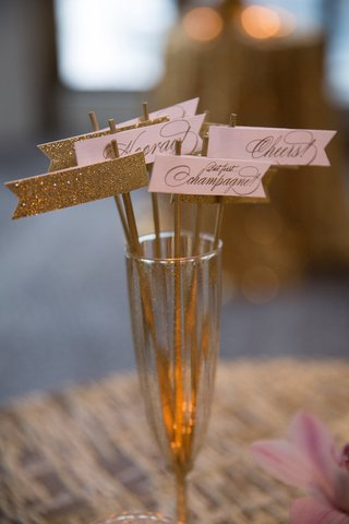 glittery-gold-and-blush-drink-stirrers-in-glittery-gilt-champagne-flute