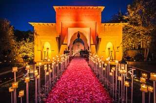 restaurant-wedding-venue-marrakech-morocco-flowers-candles-opulent-traditional-wedding-building