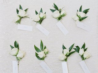 boutonnieres-with-two-small-roses-and-green-leaves