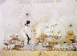 wedding-reception-dessert-bar-with-chic-black-and-white-theme-with-pink-sweet-treats