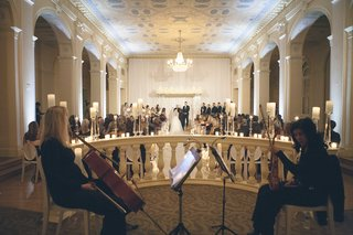 cello-player-and-violin-player-on-stage-at-biltmore-ballrooms-wedding-in-atlanta-on-new-years-eve