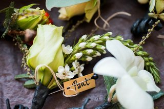 wedding-guest-rustic-boutonnieres-with-an-ivory-rose-orchid-and-greenery