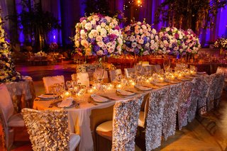 oval-table-surrounded-by-ruffled-chair-covers