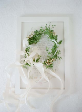 flower-girl-head-wreath-made-of-greenery-and-ribbon