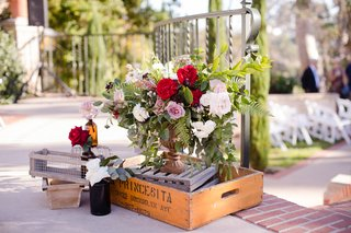 arrangement-of-red-white-and-lavender-roses-displayed-with-wine-box