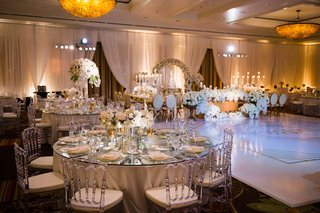 dance-floor-white-with-custom-gold-monogram-round-tables-with-lucite-acrylic-chairs-mirror-top