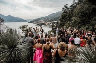 view-of-lake-como-from-lugano-switzerland-wedding-ceremony-on-cliff-overlooking-lake-italy