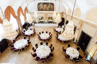 wedding-reception-overhead-view-round-tables-gold-chandeliers-painting-drapery-art-deco-feel