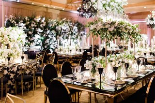 charlise-castro-and-george-springer-wedding-reception-black-gold-wedding-decor-greenery-white-flower