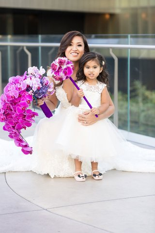adorable-flower-girl-with-minnie-mouse-fuchsia-orchid-pomander-flower-wand