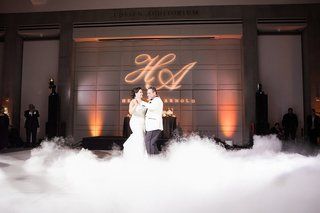 bride-in-martina-liana-trumpet-gown-dances-with-groom-in-white-tuxedo-jacket-fog-first-dance