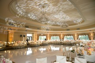 classic-wedding-reception-decorations-with-scroll-pattern-projection-gobo-on-ceiling-over-dance-floo