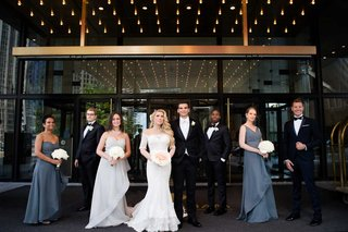 bridesmaids-in-mismatched-dresses-and-groomsmen-in-tuxedos-black-bow-ties-groom-white-tie