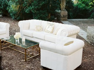outdoor-lounge-area-at-wedding-cocktail-hour-sequin-pillow-cream-couches
