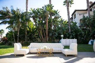 outdoor-cocktail-hour-tufted-sofa-roll-arm-settees-gold-coffee-table-tufted-panel-wedding-bar