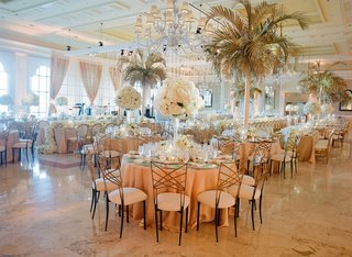 wedding-reception-ballroom-the-breakers-round-tables-white-flower-centerpiece-palm-tree-chandeliers