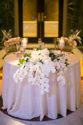sparkling-ivory-sweetheart-table-linen-wedding-orchids-centerpiece-classic-feminine