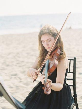 violin-player-in-black-dress-on-beach-at-cj-lana-perrys-wedding-to-miroslav-rusev-barnyashev