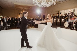 bride-in-mira-zwillinger-wedding-dress-with-mark-ingraham-overskirt-groom-in-tux-fun-first-dance