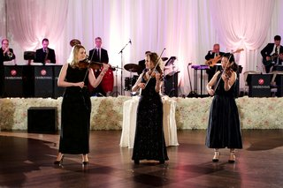 three-women-in-black-dresses-playing-the-violin-fiddle-at-wedding-reception-live-band-ivory-flowers