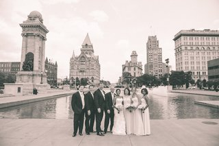 black-and-white-photo-of-bridesmaids-and-groomsmen-with-couple