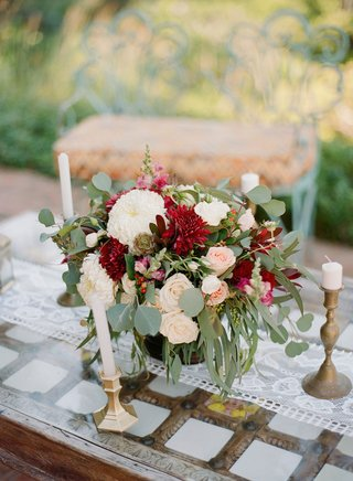 wedding-rehearsal-dinner-welcome-party-gold-candleholders-and-vase-filled-with-greenery-rose-dahlia
