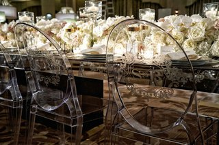 clear-acrylic-ghost-dining-chairs-with-monogram-detailing-on-round-back-wedding-reception
