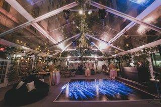wedding-reception-dj-antique-furniture-greenery-garden-vibe-dance-floor-settees-blue-lighting