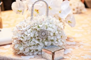 white-floral-purse-with-silver-metallic-box-on-white-table-linens