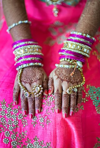 indian-american-bride-with-henna-tattoos-gold-and-fuchsia-bangles