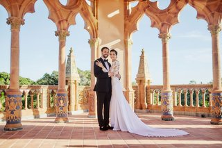 bride-in-pronovias-gown-with-lace-bodice-crepe-skirt-groom-in-tuxedo-ca-dvan-wedding