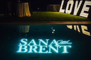 blue-light-projection-of-the-couples-names-custom-lighting