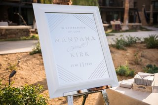 mirror-sign-in-white-frame-on-silver-stand-for-persian-armenian-wedding-white-lettering