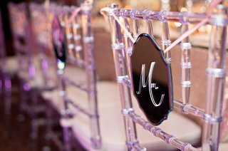 die-cut-mirror-hanging-from-clear-chair-at-reception