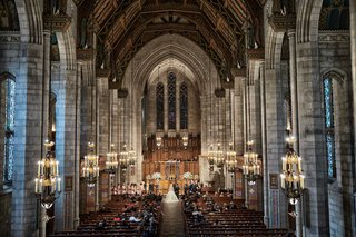 wedding-ceremony-at-fourth-presbyterian-church-with-high-ceilings-stone-columns-exposed-butresses