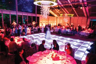 tented-wedding-reception-with-colorful-led-dance-floor
