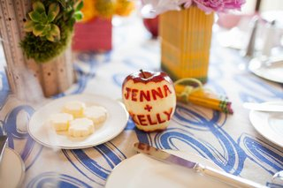 red-delicious-apple-carved-with-bride-and-groom-names-on-bridal-shower-table-decor