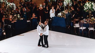 same-sex-wedding-gay-couple-grooms-sharing-their-first-dance-wearing-white-jackets