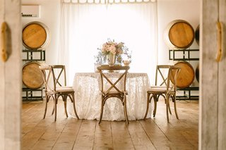 round-tablescape-wine-barrels-wood-faux-wedding-party-styled-shoot-rustic-event-lace-linen-florals