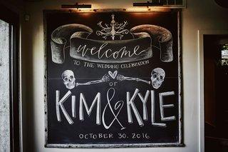 chalkboard-wedding-sign-skull-skeleton-design-halloween-wedding-weekend