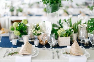 nautical-theme-wedding-with-blue-table-runner-kraft-paper-menus-and-green-centerpieces