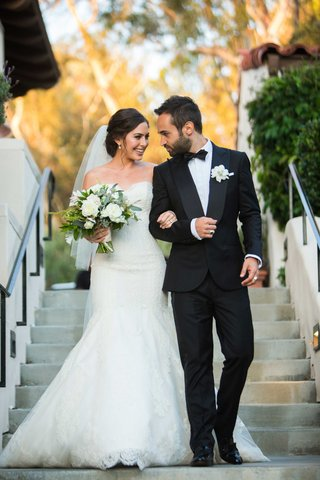 bride-in-ines-di-santo-walks-with-her-groom-during-their-first-look