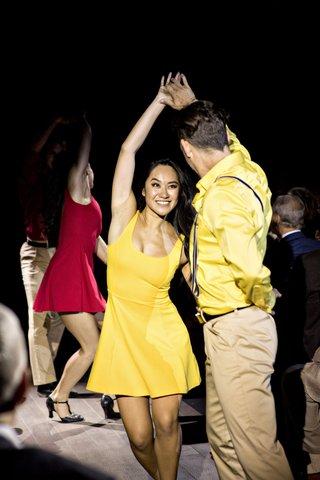 professional-dancers-in-character-shoes-yellow-red-dresses-yellow-shirt-suspenders-khaki-pants