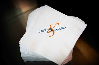 white-beverage-napkin-with-blue-and-orange-names