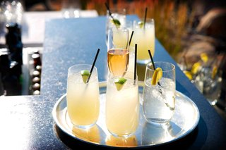 margaritas-in-glasses-with-lime-garnish-and-champagne