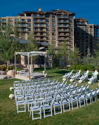 white-ceremony-chairs-on-lawn-of-park-city-resort